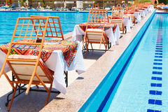 Swimming pool with tables Royalty Free Stock Photo