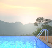 Swimming Pool And Terrace Of Blur Nature Background royalty free stock photos
