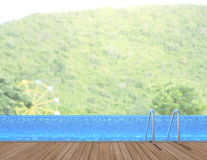 Swimming Pool And Terrace Of Blur Nature Background royalty free stock images
