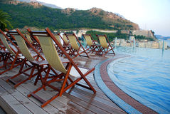 Swimming pool, terrace and outdoor chairs Stock Photo
