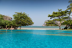 Swimming pool at thailand touristic resort beach Royalty Free Stock Photos