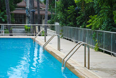 Swimming pool with three stair at hotel Stock Photo