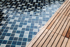 Swimming pool tile and wooden floor Stock Photo