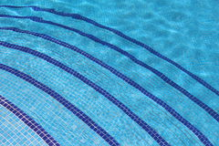 Swimming pool tiled steps. Curving tiled swimming pool steps Stock Photography