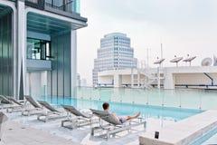 Swimming pool on top of modern condominium at downtown. Swimming pool on top of modern condominium at Bangkok, Thailand stock photography