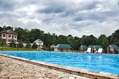 Swimming pool in Tourist base for the rest of the Walnut grove. Swimming pool in  Tourist base for the rest of the Walnut grove at the foot of the Caucasus Royalty Free Stock Image