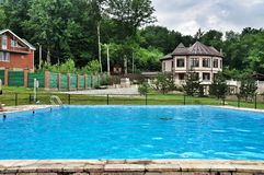 Swimming pool in Tourist base for the rest of the Walnut grove. Swimming pool in  Tourist base for the rest of the Walnut grove at the foot of the Caucasus Stock Photos