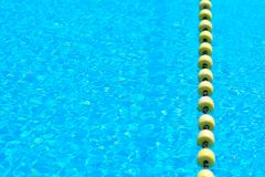 Swimming pool with transparent water, with yellow indicator float line. stock image