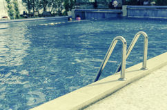 Swimming pool in tropical area Royalty Free Stock Photo