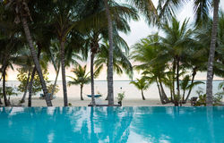 Swimming pool on tropical beach Royalty Free Stock Photo