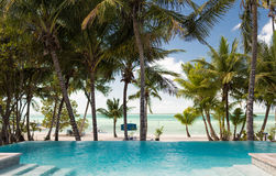 Swimming pool on tropical beach Stock Image