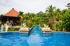 Swimming pool in tropical garden Royalty Free Stock Photography