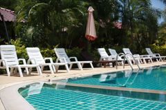 Swimming pool in tropical garden with bamboo bungalow - paradise for tourists. Stock Image