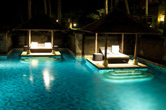 Swimming Pool In Tropical Hotel. Swimming pool looks very nice at night Royalty Free Stock Image