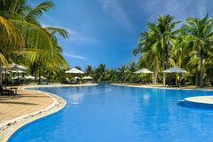 Swimming pool in tropical hotel. Mui Ne, Vietnam Royalty Free Stock Photo