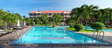 Swimming pool at tropical  resort Stock Images