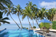 Swimming pool in a tropical resort on a bright clear day. Empty swimming pool in a tropical island resort on a bright clear day in Rarotonga , Cook Islands royalty free stock photos