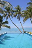 Swimming pool in a tropical resort on a bright clear day. Empty swimming pool in a tropical island resort on a bright clear day in Rarotonga , Cook Islands stock photography