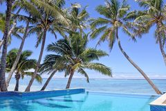 Swimming pool in a tropical resort on a bright clear day. Empty swimming pool in a tropical island resort on a bright clear day in Rarotonga , Cook Islands stock photos