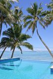 Swimming pool in a tropical resort on a bright clear day. Empty swimming pool in a tropical island resort on a bright clear day in Rarotonga , Cook Islands royalty free stock photography
