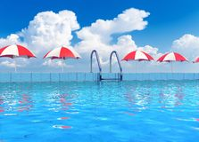 Swimming pool in tropical resort. Creative travel, tourism and summer vacations concept: scenic view of swimming pool with blue water in tropical resort Stock Image