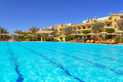 Swimming pool at tropical resort in Hurghada Royalty Free Stock Photography