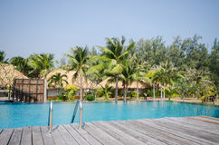 Swimming pool in tropical style resort Royalty Free Stock Photography