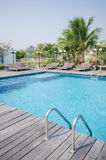 Swimming pool in tropical style resort Royalty Free Stock Photos