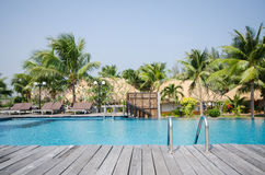 Swimming pool in tropical style resort Royalty Free Stock Images