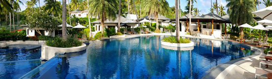 Swimming pool in the tropics Stock Images