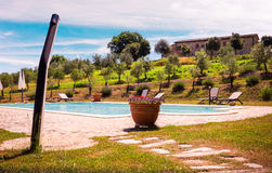 Swimming pool and tuscan nature Royalty Free Stock Photo