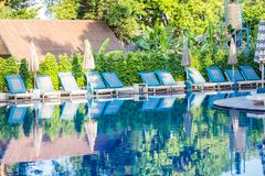 Swimming pool With umbrellas and sun loungers At the island in Thailand royalty free stock image