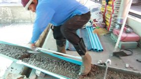 Swimming pool under construction, being sprayed on rebar for new swimming pool. Thailand stock video footage