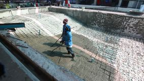 Swimming pool under construction, being sprayed on rebar for new swimming pool. Thailand stock video