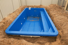 Swimming pool under construction. Royalty Free Stock Photo
