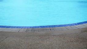 Swimming pool under rain footage HD stock video footage