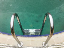 Swimming pool under the rain. Which is partially frozen Stock Photo