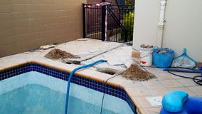 Swimming pool under repair with danger tape. A Swimming pool under repair with danger tape Royalty Free Stock Photo