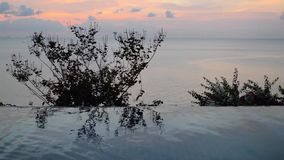 Swimming pool under sunset near the sea stock footage