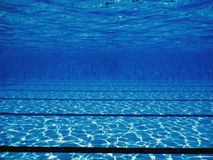 Swimming pool underwater. Underwater background Stock Images
