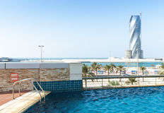 Swimming pool and United Tower under construction Royalty Free Stock Photography