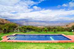 Swimming pool with a view of the andes mountains Stock Photo