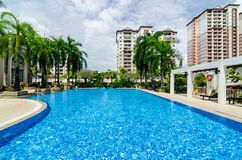 Swimming Pool. View of a swimming pool with apartments in the background royalty free stock images