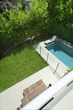 Swimming pool view from balcony. Swimming pool and backyard view from balcony Royalty Free Stock Images