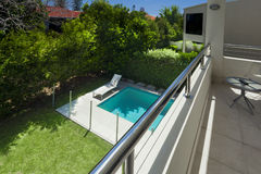 Swimming pool view from balcony. Swimming pool and backyard view from balcony Stock Images