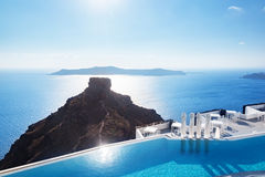 Swimming pool with a view on Caldera over Aegean sea, Santorini, Greece Stock Photos