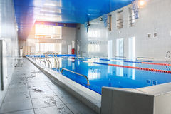 Swimming pool, view from indoors. Interior inside. Healthy lifestyle. Water sports and therapeutic procedures. Royalty Free Stock Image