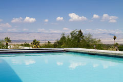 Swimming pool with a view of the mountains Stock Photo