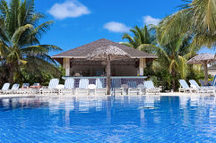 Swimming pool view with sun lounger and a bar in Cuba Stock Images