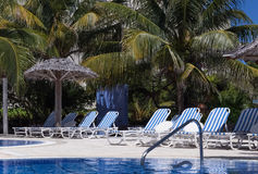 Swimming pool view with sun lounger in Cuba Stock Photos